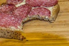 En biten skiva av salami royaltyfria bilder