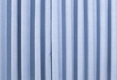 En blå gardin Fotografering för Bildbyråer
