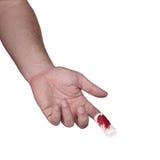 En blödande fingerspets täckas med en förbinda. Royaltyfri Foto