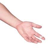 En blödande fingerspets täckas med en förbinda. Fotografering för Bildbyråer