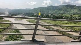 En bro i Abottabad, Haripur sida med flödande vatten royaltyfria bilder
