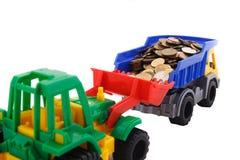 En bulldozer och en lastbil Arkivfoto