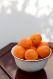 En bunke av kumquats Arkivbilder