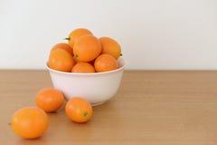 En bunke av kumquats Royaltyfri Bild
