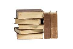En bunt av böcker på en vit bakgrund Arkivbilder