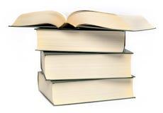En bunt av fyra böcker Arkivfoton