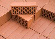 En bunt av nya tegelstenar för röd lera Royaltyfria Foton