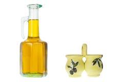 En buteljera av olivolja Arkivbild