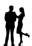 Man kopplar ihop manen, och kvinnaanseende vänder mot - - vänder mot Royaltyfria Bilder