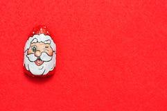 En choklad som täckas med omslaget för framsida för Santa Claus ` s Royaltyfri Foto