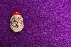 En choklad som täckas med omslaget för framsida för Santa Claus ` s Royaltyfri Bild