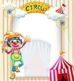 En cirkusingång med en clown Arkivbilder
