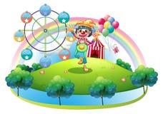 En clown med en blomma i en ö med en karneval Royaltyfri Bild