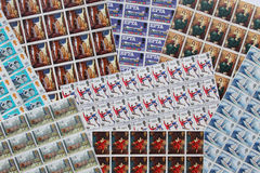 En colourfullsamling av den brittiska stämpeln för mintkaramellen täcker Arkivbilder