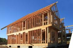 En construction à la maison de bois de construction Photos stock