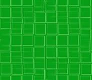 En cuadrados verdes de un verde del fondo Imágenes de archivo libres de regalías