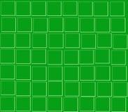 En cuadrados verdes de un verde del fondo Fotos de archivo libres de regalías