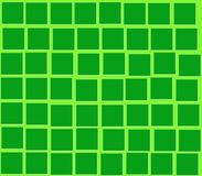 En cuadrados verdes de un verde del fondo Foto de archivo