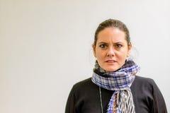 En dam Looking på kameran med förakt royaltyfria bilder