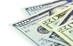 En del av US dollar på vit bakgrund Arkivfoto