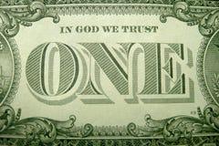 EN DIOS CONFIAMOS EN y UNO enmarcados adornado por los elementos decorativos del dólar americano imágenes de archivo libres de regalías