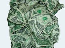 En dollar fakturerar skrynkligt i hög fotografering för bildbyråer