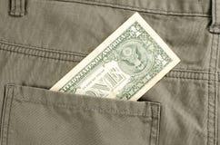 En dollar i bakficka Royaltyfria Bilder