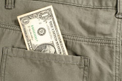 En dollar i bakficka Arkivbilder