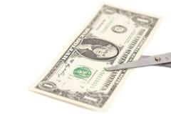 En dollar klipper med sax Royaltyfri Foto
