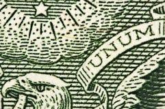 En-dollar räkning, huvud av en örn ett ord UNUM Makro arkivbilder