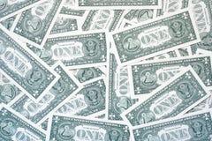 En dollar räkningar från den tillbaka enkla bakgrunden av en dollar arkivbilder