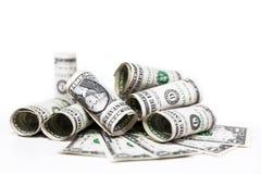 En dollar sedlar framme av vit Arkivfoto