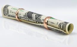 En-dollaren räkningen rullade in i ett rör
