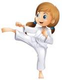 En driftig ung kvinna som gör karate stock illustrationer