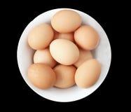 En-Eier in einer weißen Schüssel Lizenzfreie Stockfotos