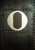 0 en el acero con los remaches Fotografía de archivo libre de regalías