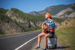 En el camino con música Imagen de archivo