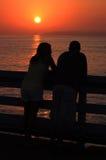 En el embarcadero en la puesta del sol Imágenes de archivo libres de regalías