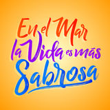 En el mar la vida es mas sabrosa - At sea life is more tasty spanish text, Traditional Latin phrase. Vector lettering - eps available Stock Photos
