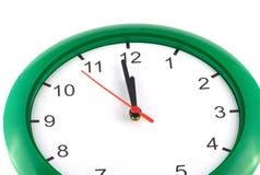 12 en el reloj de pared aislado Fotografía de archivo libre de regalías
