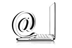 En el símbolo con la computadora portátil Foto de archivo libre de regalías