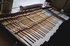 En el taller del piano Fotos de archivo libres de regalías