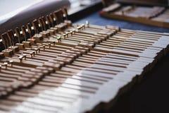 En el taller del piano Imagen de archivo libre de regalías