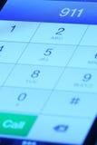 911 en el teléfono móvil Fotos de archivo libres de regalías