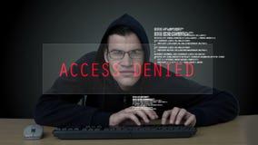 En en hackerkuggning som loggar in på en datacenter stock video