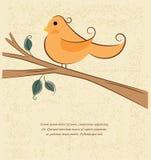 en fågel på en filial Arkivbild
