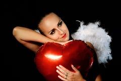 En försiktig ängel med en ballong Royaltyfria Foton