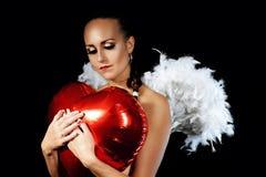 En försiktig ängel med en ballong Royaltyfri Bild