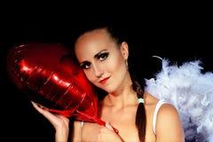 En försiktig ängel med en ballong Royaltyfria Bilder