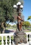 En felik staty i La Parque de La Bateria, Malaga Arkivbild